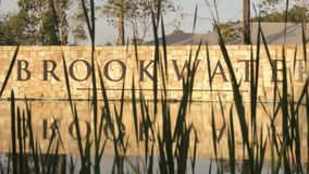 BROOKWATER, BRISBANE, AUSTRALIA - DECEMBER 20 2014: The Brookwater sign at the entrance of the estate and golf course. The Brookwater sign at the entrance of stock video footage