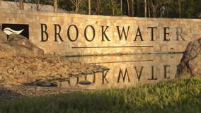 BROOKWATER, BRISBANE, AUSTRALIA - DECEMBER 20 2014: The Brookwater sign at the entrance of the estate and golf course. The Brookwater sign at the entrance of the stock video