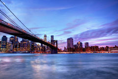 Brookyln bridge and Manhattan skyline at blue hour time. Royalty Free Stock Photos