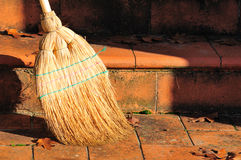 Broom. In an external staircase stock image