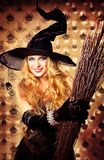 Broom. Charming halloween witch with broom over vintage background royalty free stock photos