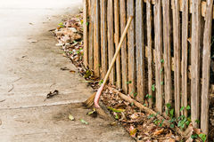 Broom against the wooden fence, home fence, background texture. Broom against the wooden fence, background texture Royalty Free Stock Photo