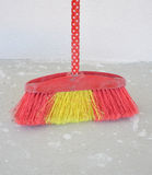 Broom besom on a concrete background Stock Image
