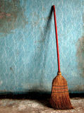 Broom on a blue wall Royalty Free Stock Photos