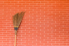 Broom on brick wall Stock Photos