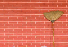 Broom on brick wall Stock Image