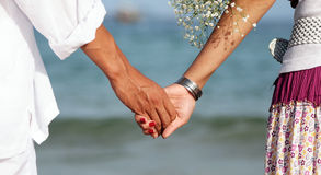 Broom and bride, hand and hand Stock Photo