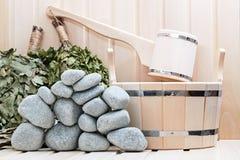 Broom, bucket,  stones and bath accessories. Stock Photos