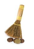 Broom and cents Stock Photos