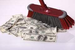Broom clean dollars on floor. Concept Stock Images