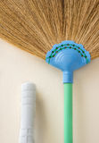 The broom clean wall Stock Images