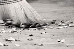 Broom with debris flying Royalty Free Stock Images