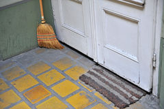 Broom at the door in the house Royalty Free Stock Images