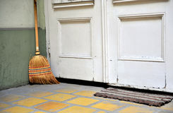 Broom at the door Royalty Free Stock Photos