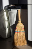 Broom and dumpster Stock Photos