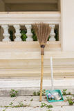 Broom and dust pan lean on wall Stock Images