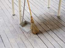 Broom and dustpan. On old wood floor Stock Photography