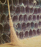Broom and fishnets in vintage tone Royalty Free Stock Photography