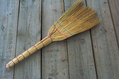 Broom on the floor. The old Board the subject of tool clean Stock Image