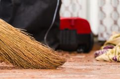 Broom on the floor. Repair in the room. A broom stands on a wooden floor. Parquet board. New floor. Sweeping the floor. Broom Royalty Free Stock Images