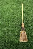 Broom on green grass Stock Photo