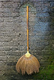 Broom hanging on vintage wall Royalty Free Stock Images
