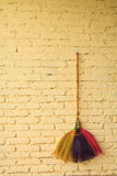 Broom hanging on the wall Stock Image