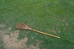 Broom with lawn Stock Photography