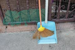 Broom made of grass and dustpan,  Set of cleaning home Royalty Free Stock Images