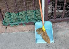 Broom made of grass and dustpan,  Set of cleaning home Stock Photos