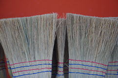 Broom market. Red back ground Royalty Free Stock Photography