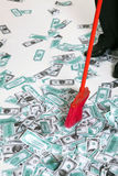 Broom in the money. Red broom in the money Royalty Free Stock Images