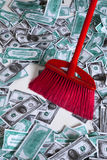 Broom in the money. Red broom in the money Stock Photography