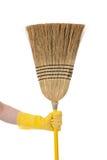 broom obowiązki domowe ręki mienia sprzątania temat Zdjęcia Royalty Free