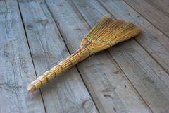 Broom on the old boards Stock Image