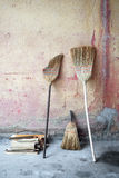Broom. An old broomstick leaning against the wall Stock Images