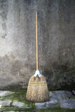 Broom over a grunge background Stock Photography
