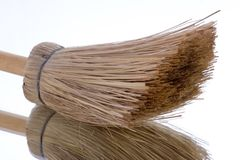 Broom over mirror Stock Photo