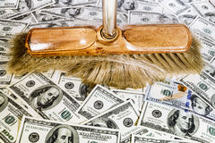 Broom over one hundred dollar bills Royalty Free Stock Photos