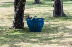 Broom and plastic basket Royalty Free Stock Photos