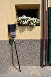 Broom propped against the wall Stock Image