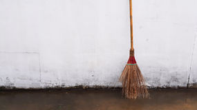 Broom. Put forward concrete wall Royalty Free Stock Photography