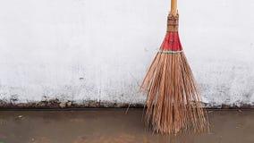 Broom. Put forward concrete wall Stock Photo
