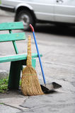 Broom, scoop and bench. Bench, broom and scoop on the city street Royalty Free Stock Photography