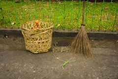 Broom stick and trash basket made from bamboo photo taken in jakarta indonesia Royalty Free Stock Images