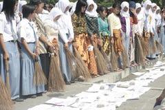 Broom Sticks Anti-Corruption Action The Schoolgirl Royalty Free Stock Photography