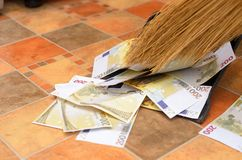 Broom sweep money in the scoop. Broom sweep a lot of dollar and euro bills in the scoop Stock Photography