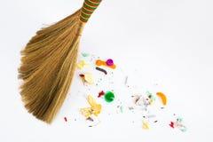 Broom sweeping various debris. A new broom sweeping various debris and mud Royalty Free Stock Photography