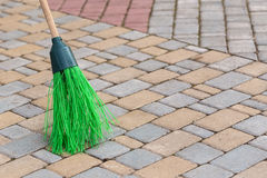 Broom tile. A broom to clean the sidewalk tiles Royalty Free Stock Photos