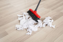 Broom With Torn White Papers. On Hardwood Floor stock photos